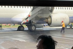 China Airlines Boeing 737 Bursts Both Left Main Tyres on Landing